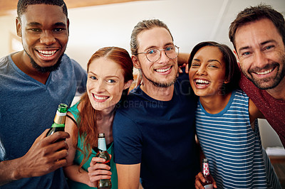 Buy stock photo Portrait of a group of colleagues talking and drinking beers together while winding down after work