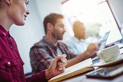 Buy stock photo Shot of a group of businesspeople working at a table in an office