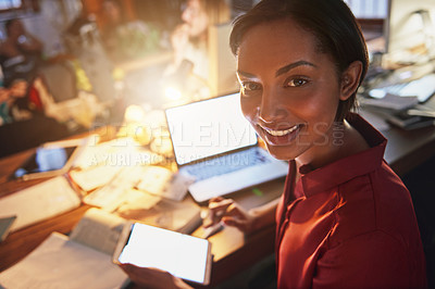 Buy stock photo Portrait of a smiling young woman working on a laptop and digital tablet in an office in the evening