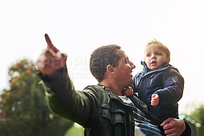 Buy stock photo Cropped shot of a father bonding with his son outside