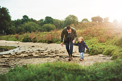 Buy stock photo Shot of a father out for a walk with his little son