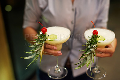 Buy stock photo Cropped shot of an unrecognizable waitress serving drinks