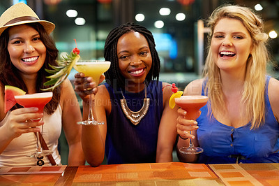 Buy stock photo Cropped portrait of three young girlfriends having drinks at a bar