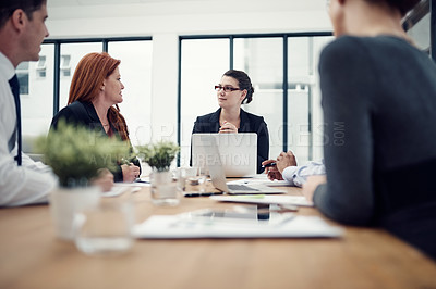Buy stock photo Cropped shot of group of businesspeople having a meeting in an office