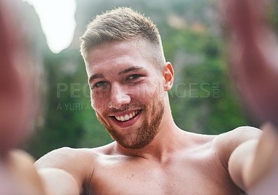 Buy stock photo Portrait of a handsome young man taking a selfie outside