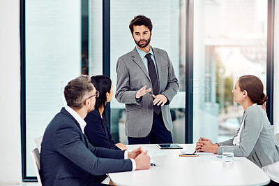 Buy stock photo Cropped shot of a group of businesspeople meeting in the boardroom