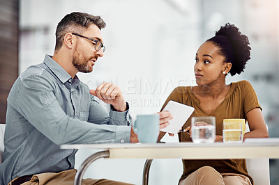 Buy stock photo Cropped shot of two businesspeople working together in their office