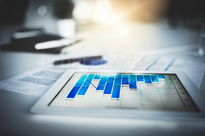 Buy stock photo Closeup shot of graphs on a digital tablet in an office