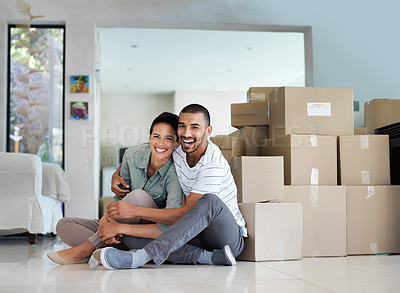 Buy stock photo Portrait of a happy young couple sitting on their living room floor on moving day