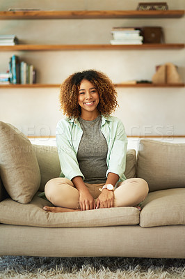 Buy stock photo Full length portrait of an attractive young woman sitting on her sofa at home