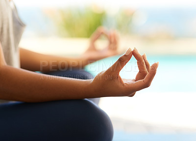 Buy stock photo Cropped shot of an unrecognizable young woman meditating outdoors