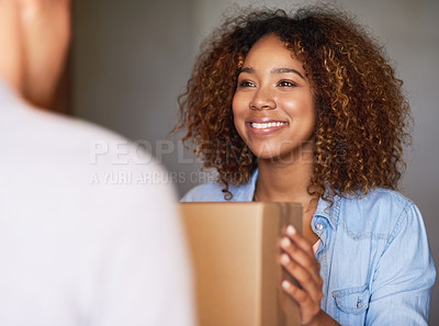 Buy stock photo Cropped shot of a woman receiving her package from the delivery man