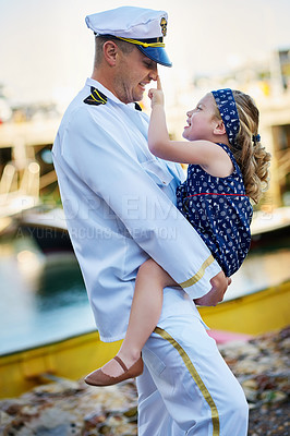 Buy stock photo Shot of a father in a navy uniform bonding with his little girl on the dock