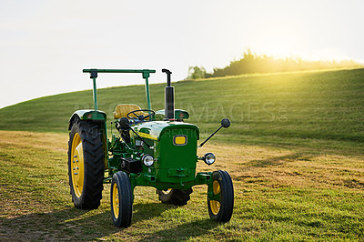 Buy stock photo Shot of a tractor on an open piece of land