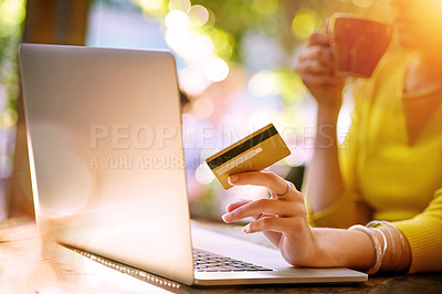 Buy stock photo Shot of an unrecognizable young woman shopping online