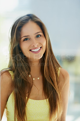 Buy stock photo Portrait of an attractive and happy young woman