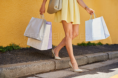 Buy stock photo Cropped shot of a young woman out in the city on a shopping spree