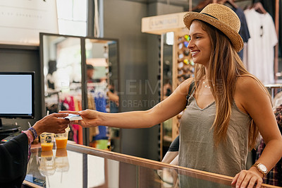 Buy stock photo Shot of a young woman out on a shopping spree