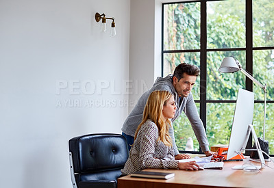 Buy stock photo Shot of a happy young couple working together in their home office