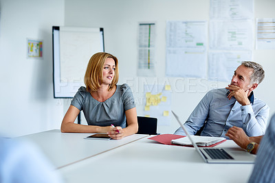 Buy stock photo Shot of a group of coworkers having a meeting in an office