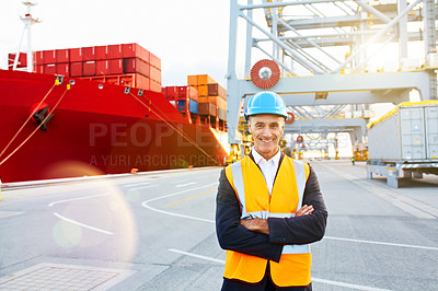 Buy stock photo Portrait of a mature man in workwear standing in a large commercial dock