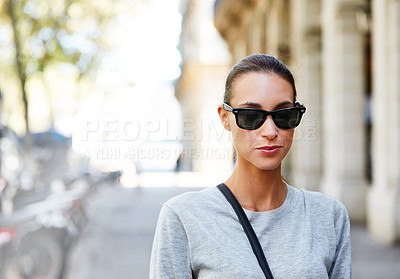 Buy stock photo Portrait of a stylish young woman walking in the city