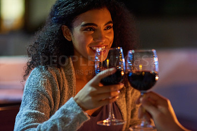 Buy stock photo Cropped shot of a young couple making a toast