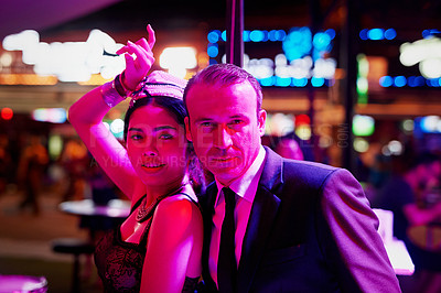 Buy stock photo Portrait of a seedy businessman standing with a bar girl in a go go bar in Thailand