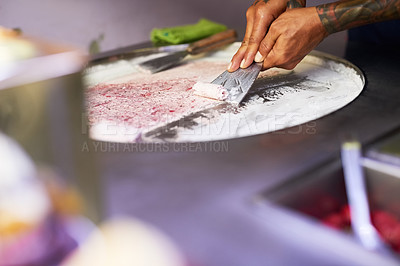Buy stock photo Shot of an unidentifiable food vendor preparing a sweet treat at a market stall