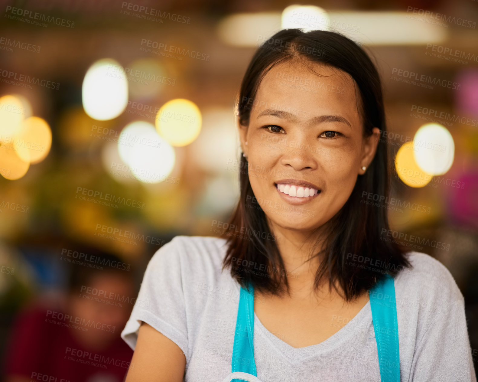 Buy stock photo Portrait of a happy young food vendor posing at the market