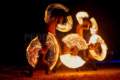 Buy stock photo Shot of a fire performance on a beach in Thailand