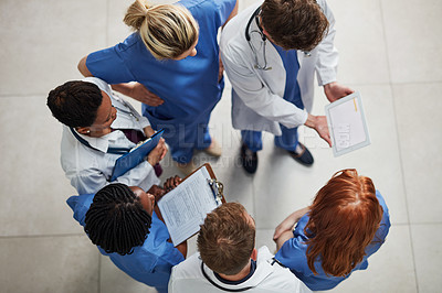 Buy stock photo High angle shot of a group of medical practitioners working together in a hospital