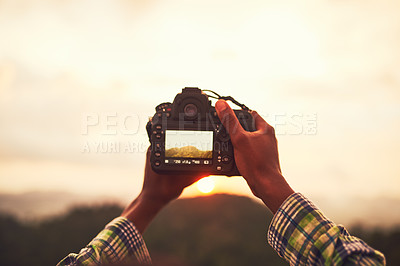Buy stock photo Closeup shot of an unidentifiable man taking a photo on a camera outside