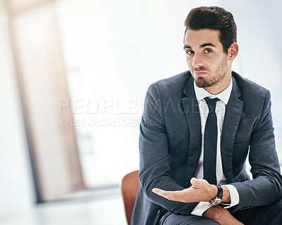 Buy stock photo Portrait of a trendy young businessman indicating copyspace next to him in the office