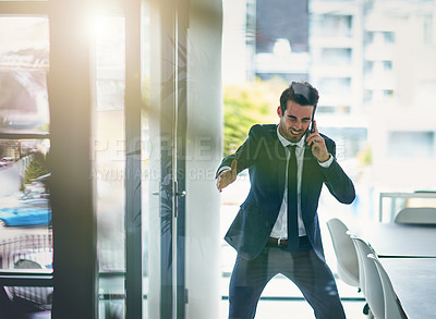 Buy stock photo Shot of a young businessman losing his temper while talking on his cellphone
