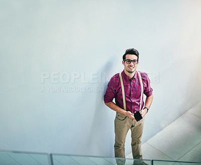 Buy stock photo High angle portrait of a handsome young designer standing in his office