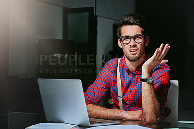 Buy stock photo Cropped portrait of a frustrated young designer looking lost while working on his laptop