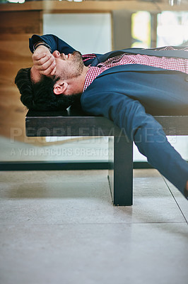 Buy stock photo Shot of a tired businessman taking a break to rest in the office