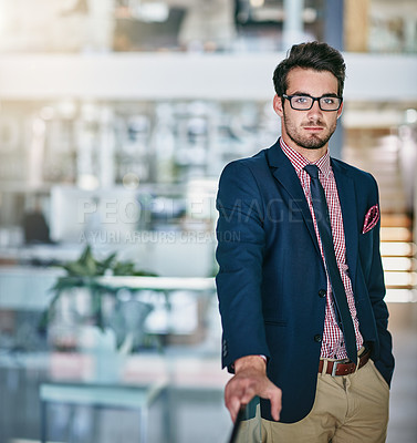 Buy stock photo Portrait of a trendy young businessman posing confidently in the office