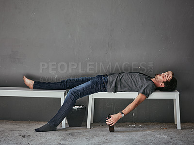 Buy stock photo Full length shot of a beaten and bruised drunk man sleeping on a bench