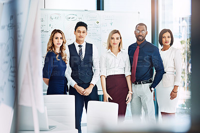 Buy stock photo Cropped portrait of a group of businesspeople standing in the office