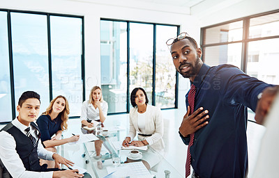 Buy stock photo Cropped shot of a young businessman giving a presentation in the boardroom