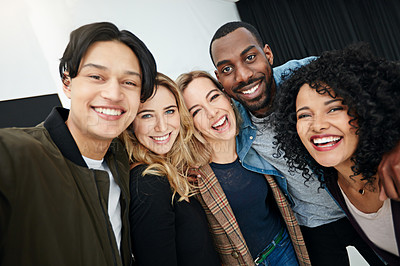 Buy stock photo Portrait of a group of happy and diverse young colleagues working together in a modern office