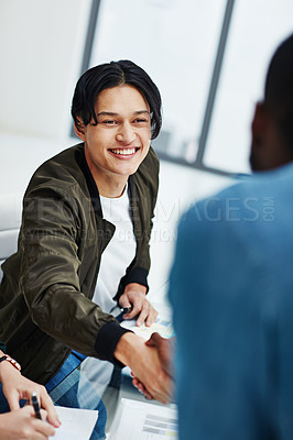 Buy stock photo Shot of colleagues shaking hands during a brainstorming session at work