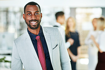 Buy stock photo Portrait of an ambitious young businessman in a modern office with his colleagues in the background