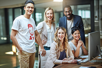 Buy stock photo Portrait of a group of colleagues using a computer together in a modern office