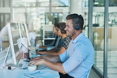 Buy stock photo Shot of a team of call center agents working in an office