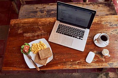 Buy stock photo High angle shot of a laptop and freshly made breakfast on a table
