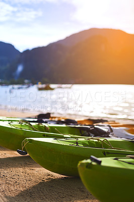 Buy stock photo Shot of three canoes on the shore of a tropical beach