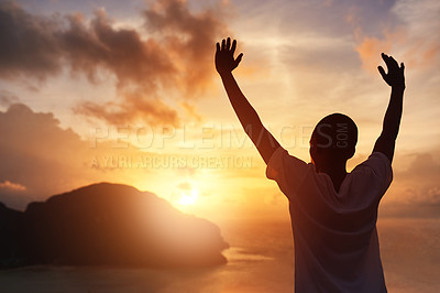 Buy stock photo Rearview shot of a young tourist raising his arms against a sunset view
